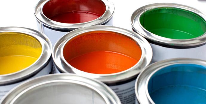 colourful buckets of paint for painting and decorating